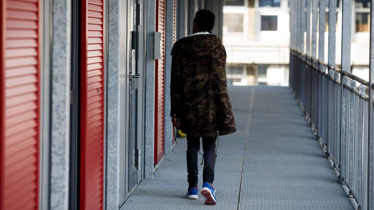 Un jeune migrant photographié à l'Hospice général de Genève, en 2016. [Salvatore Di Nolfi - Keystone]