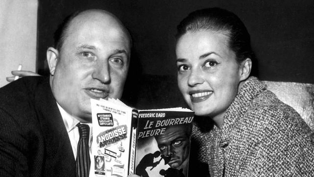 Frédéric Dard et Jeanne Moreau en 1957. [Keystone]