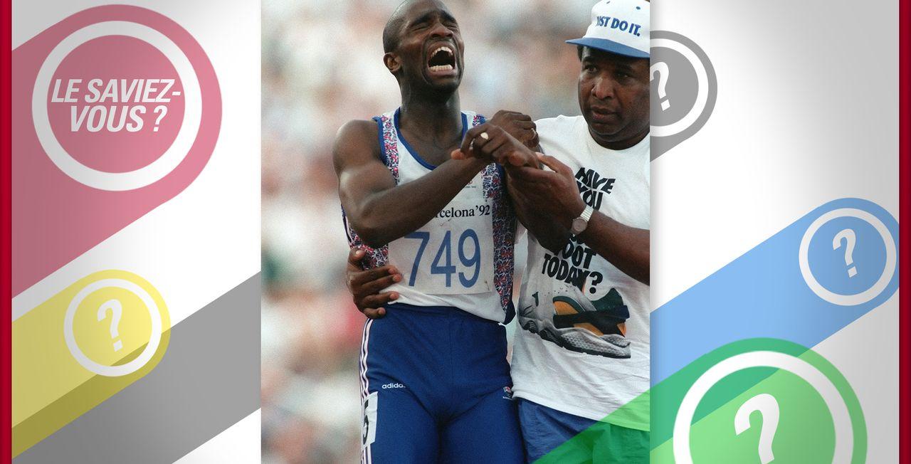 Derek Redmond termine sa demi-finale du 400m aidé par son père. [Pascal Pavani - AFP]