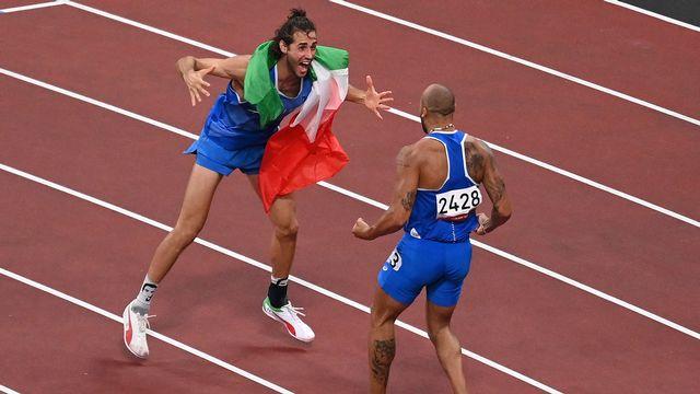 Gianmarco Tamberi et Lamont Marcell Jacobs, héros italiens d'une journée folle pour nos voisins. [Jonathan Nackstrand - AFP]