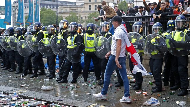 La police de Londres avait procédé à 86 arrestations et annoncé que 19 policiers avaient été blessés. [Peter Morrison - AP]