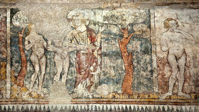 Adam et Eve confronté.e au fruit défendu dans le Jardin d'Eden, une fresque sur la Genèse.  [Philippe Roy / Aurimages - AFP]