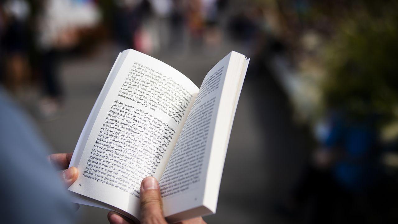 Les nombreux partenaires de la campagne veulent favoriser l'accès à la lecture. Image d'illustration [JEAN-CHRISTOPHE BOTT - KEYSTONE]