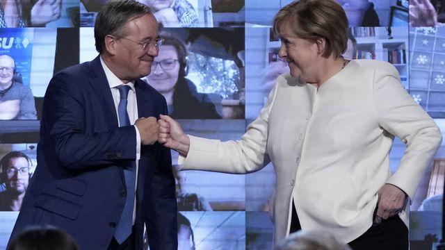 Angela Merkel s'engage aux côtés d'Armin Laschet. [AP Photo/Matthias Schrader - Keystone]