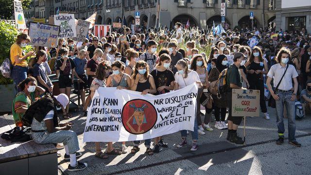 Une manifestation pour la protection du climat à Berne. [Peter Schneider - Keystone]
