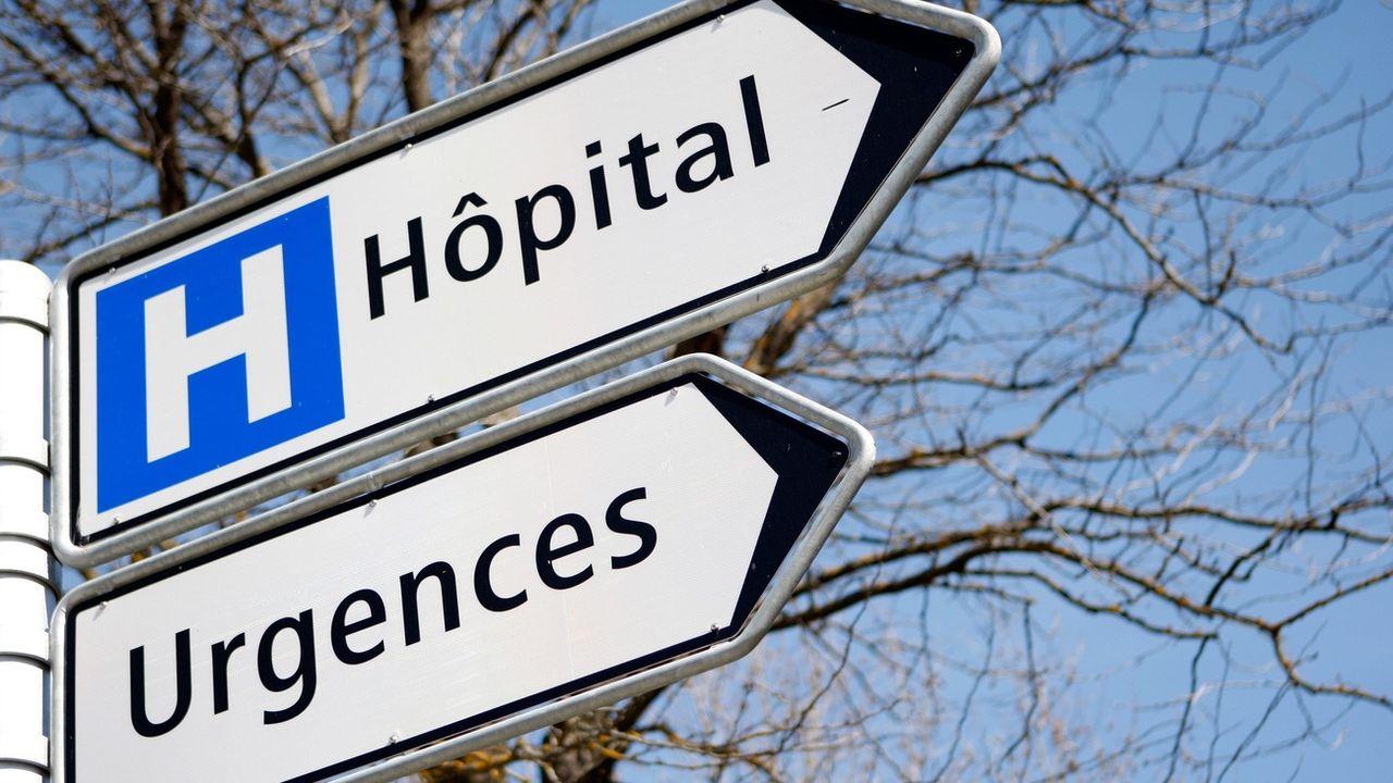 Un panneau indique l'entrée de l'hôpital de Sion. [JEAN-CHRISTOPHE BOTT - KEYSTONE]
