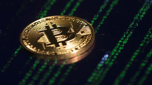 Le bitcoin franchit un nouveau cap historique à plus de 66'000 dollars. [Mehmet Aliozcan - Anadolu Agency]