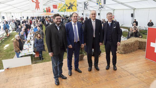 Les UDC Kevin Grangier, Michael Buffat, Guy Parmelin et Marco Chiesa lors de l'assemblée de l'UDC à Montricher. [Cyril Zingaro - Keystone]