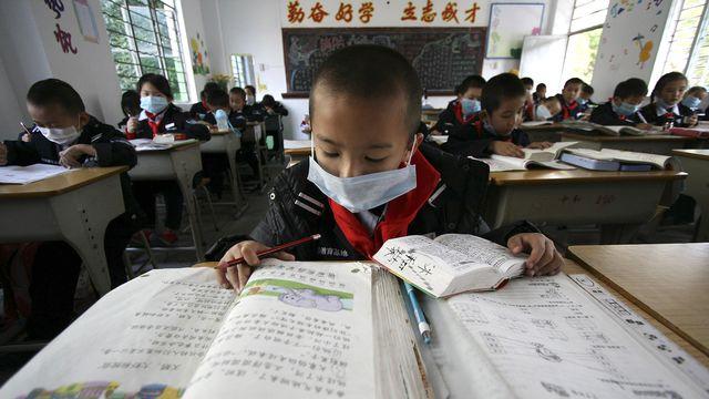 La pression est forte dès le plus jeune âge à l'école en Chine. [AP/Keystone]